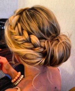 Add a braid to a simple bun or ponytail to make it look more unique 2