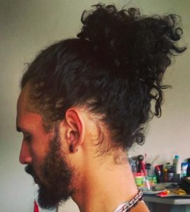For longer hair, a man bun can look even better than what you think