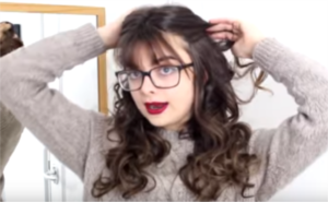 half up hairstyle with bangs and glasses