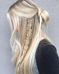 Braid accent in a simple half up half down hairstyles with buns