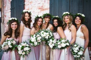 Bridesmaids' hairstyles with flowers