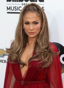 Mid half up half down ponytail hairstyle jlo